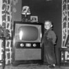 Doug Monaghen poses with the Monaghen's console TV at 3212 Milton, Dallas, Texas, 1951. This replaced the smaller Admiral TV and console radio.