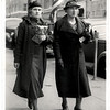 Anna Mae Lueb (L) and her mother Mary, Dallas, Texas, 1930's. This image is a postcard. Taken by a photographer set up on the street to photograph people as they walked by.