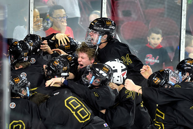 Monarch Defeats Regis Jesuit in State Hockey Championship