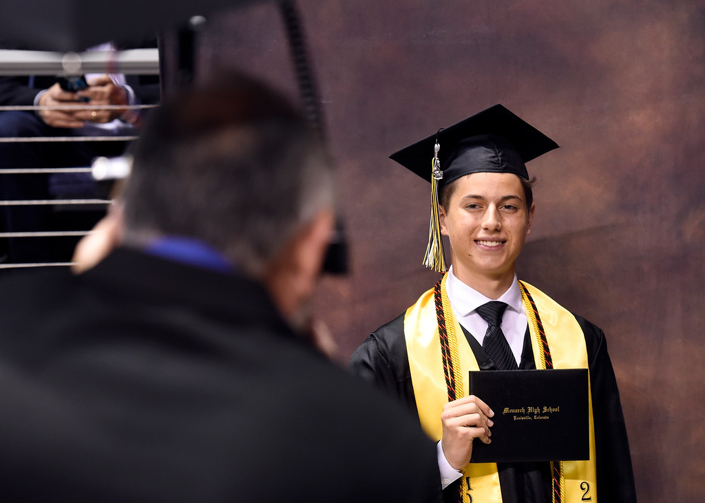 . Monarch High School\'s Marcus Cassar has his photograph taken before recieving his diploma during a graduation ceremony on Friday at the 1st Bank Center in Broomfield. For more photos of Monarch High School graduation go to www.dailycamera.com Jeremy Papasso/ Staff Photographer/ May 19, 2017
