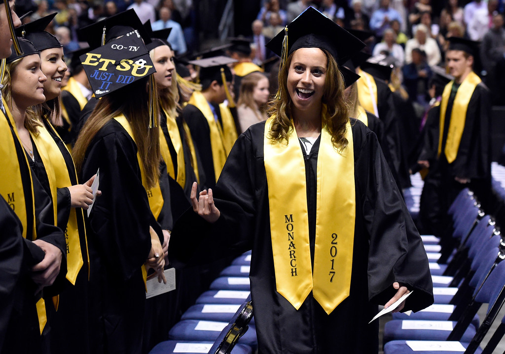 . Monarch High School\'s Rita Trick signals to her family in the crowd during a graduation ceremony on Friday at the 1st Bank Center in Broomfield. For more photos of Monarch High School graduation go to www.dailycamera.com Jeremy Papasso/ Staff Photographer/ May 19, 2017