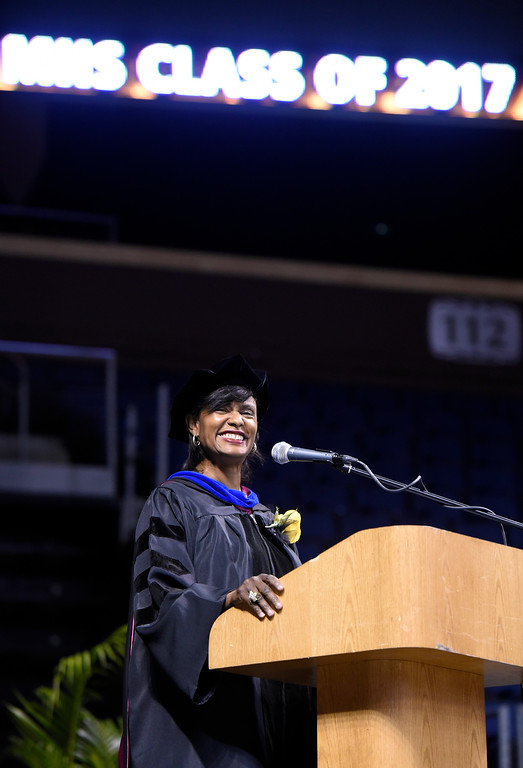 . Monarch High School principal Jerry Anderson smiles as her graduates are seated during a graduation ceremony on Friday at the 1st Bank Center in Broomfield. For more photos of Monarch High School graduation go to www.dailycamera.com Jeremy Papasso/ Staff Photographer/ May 19, 2017