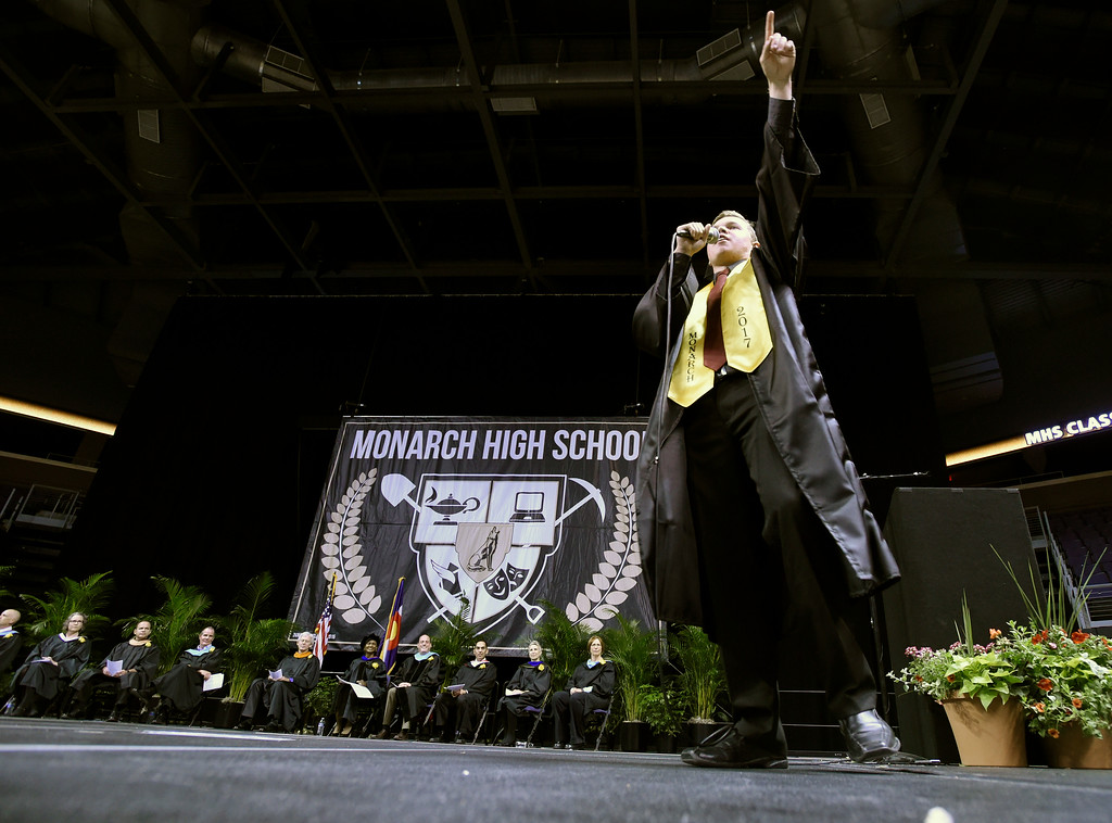. Monarch High School\'s Ronan Dowling raps on stage during a graduation ceremony on Friday at the 1st Bank Center in Broomfield. For more photos of Monarch High School graduation go to www.dailycamera.com Jeremy Papasso/ Staff Photographer/ May 19, 2017