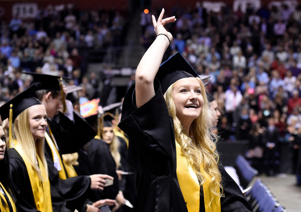 . Monarch High School\'s Megan Ziebold waves to her family in the crowd during a graduation ceremony on Friday at the 1st Bank Center in Broomfield. For more photos of Monarch High School graduation go to www.dailycamera.com Jeremy Papasso/ Staff Photographer/ May 19, 2017