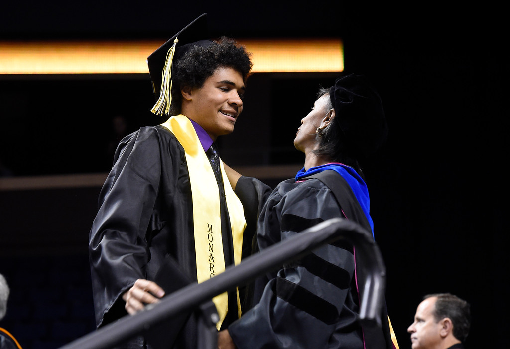 . Monarch High School\'s Isaac Green is hugged by principal Jerry Anderson during a graduation ceremony on Friday at the 1st Bank Center in Broomfield. For more photos of Monarch High School graduation go to www.dailycamera.com Jeremy Papasso/ Staff Photographer/ May 19, 2017