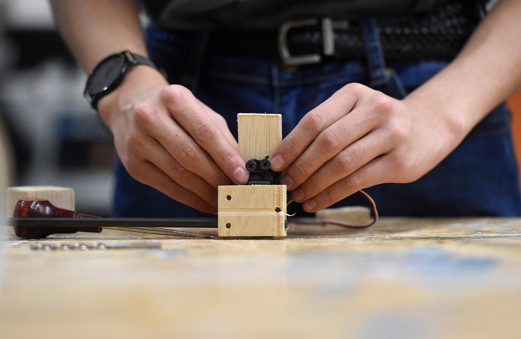 . LOUISVILLE, CO - NOVEMBER 27, 2018: Monarch High School\'s Riley Carpenter puts some finishing touches on a component of a robot while testing and demonstrating their robots on Tuesday at Monarch High School in Louisville. For more photos of the robotics team in action go to dailycamera.com (Photo by Jeremy Papasso/Staff Photographer)
