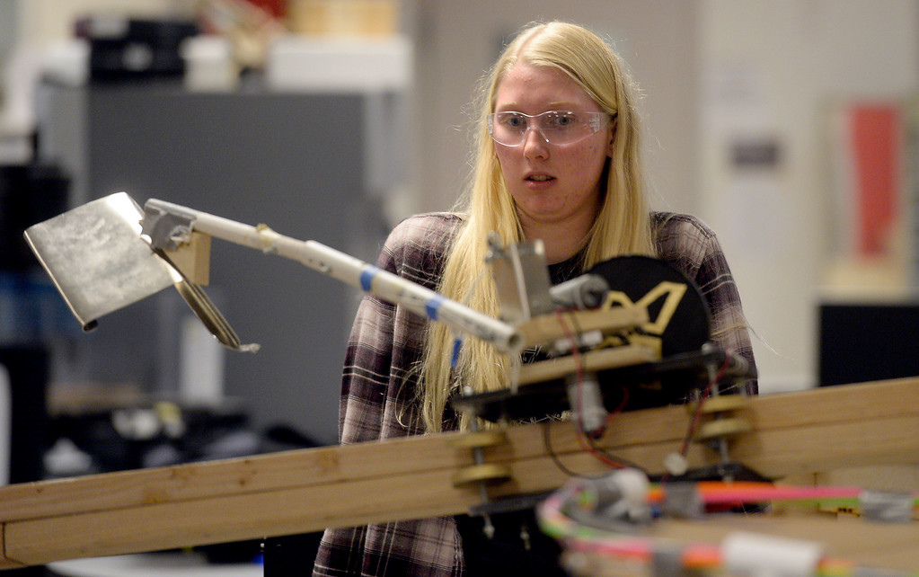 . LOUISVILLE, CO - NOVEMBER 27, 2018: Monarch High School\'s Maddie Fox watches as a robot moves down a track while testing and demonstrating their robots on Tuesday at Monarch High School in Louisville. For more photos of the robotics team in action go to dailycamera.com (Photo by Jeremy Papasso/Staff Photographer)