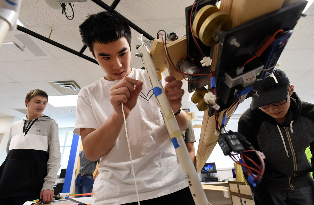 . LOUISVILLE, CO - NOVEMBER 27, 2018: Monarch High School\'s Jordan Mosakowski repairs a part of a team robot while testing and demonstrating their robots on Tuesday at Monarch High School in Louisville. For more photos of the robotics team in action go to dailycamera.com (Photo by Jeremy Papasso/Staff Photographer)
