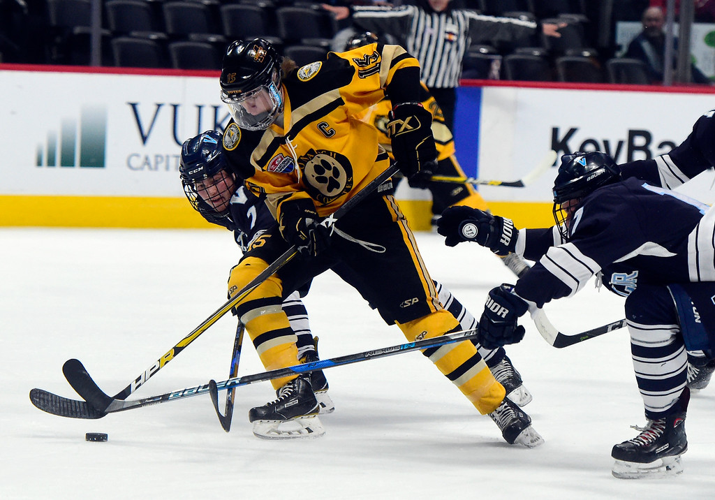 . Monarch Hockey\'s Leo Felt tries to move the puck past a swarm of defenders during a Final Four playoff game against Valor Christian on Thursday at the Pepsi Center in Denver. Monarch lost the game 4-0. More photos: BoCoPreps.com Jeremy Papasso/ Staff Photographer 03/01/2018