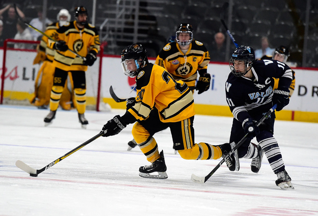 . Monarch Hockey\'s Liam Carvalho moves the puck past Luke Wheeler during a Final Four playoff game against Valor Christian on Thursday at the Pepsi Center in Denver. Monarch lost the game 4-0. More photos: BoCoPreps.com Jeremy Papasso/ Staff Photographer 03/01/2018