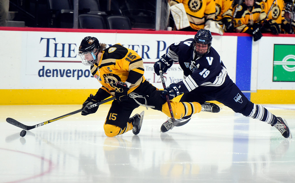 . Monarch Hockey\'s Leo Felt fights for the puck with Blake Buchanan during a Final Four playoff game against Valor Christian on Thursday at the Pepsi Center in Denver. Monarch lost the game 4-0. More photos: BoCoPreps.com Jeremy Papasso/ Staff Photographer 03/01/2018