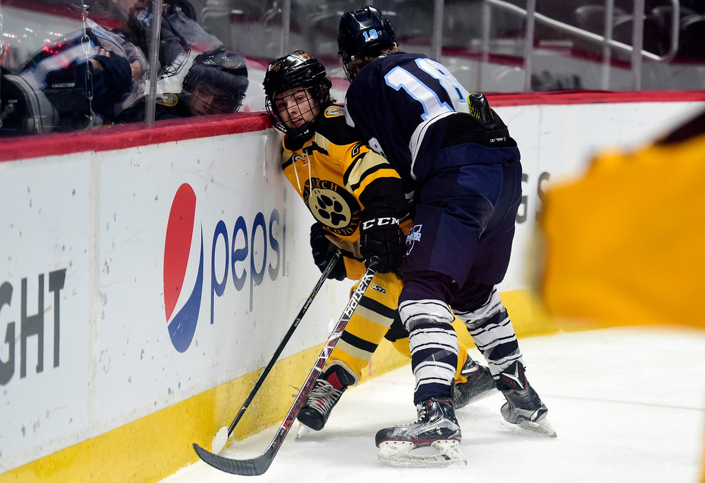 . Monarch Hockey\'s Alex Scatena gets checked into the boards by Spencer Corley during a Final Four playoff game against Valor Christian on Thursday at the Pepsi Center in Denver. Monarch lost the game 4-0. More photos: BoCoPreps.com Jeremy Papasso/ Staff Photographer 03/01/2018