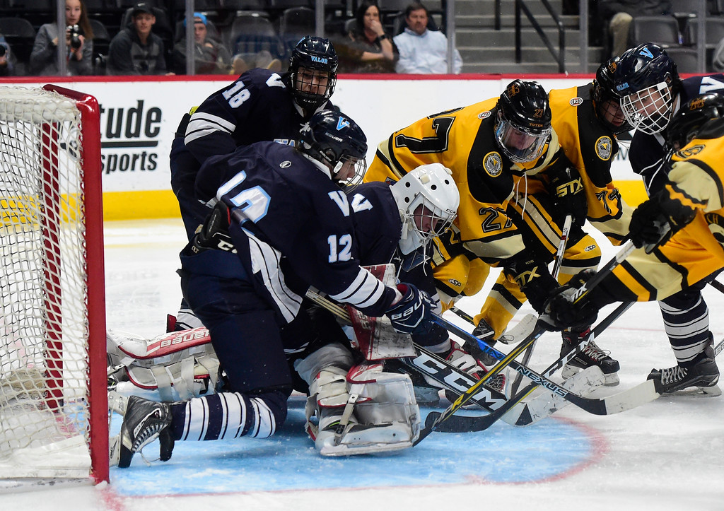 . Monarch Hockey\'s Palmer McQuade, at center, tries to score during a Final Four playoff game against Valor Christian on Thursday at the Pepsi Center in Denver. Monarch lost the game 4-0. More photos: BoCoPreps.com Jeremy Papasso/ Staff Photographer 03/01/2018