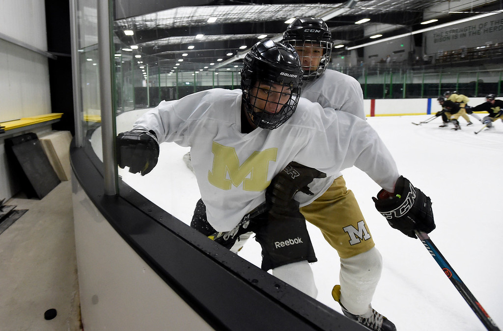 . SUPERIOR, CO - NOVEMBER 28, 2018: Monarch High School hockey players Sheen Steinbarth, at front, and Caleb Guo fight for the puck during practice on Wednesday at the Sports Stable in Superior. More photos: BoCoPreps.com Jeremy Papasso/ Staff Photographer