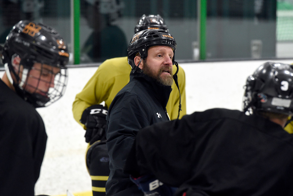 . SUPERIOR, CO - NOVEMBER 28, 2018: Monarch High School hockey Head Coach Jimmy Dexter talks with his team during practice on Wednesday at the Sports Stable in Superior. More photos: BoCoPreps.com Jeremy Papasso/ Staff Photographer