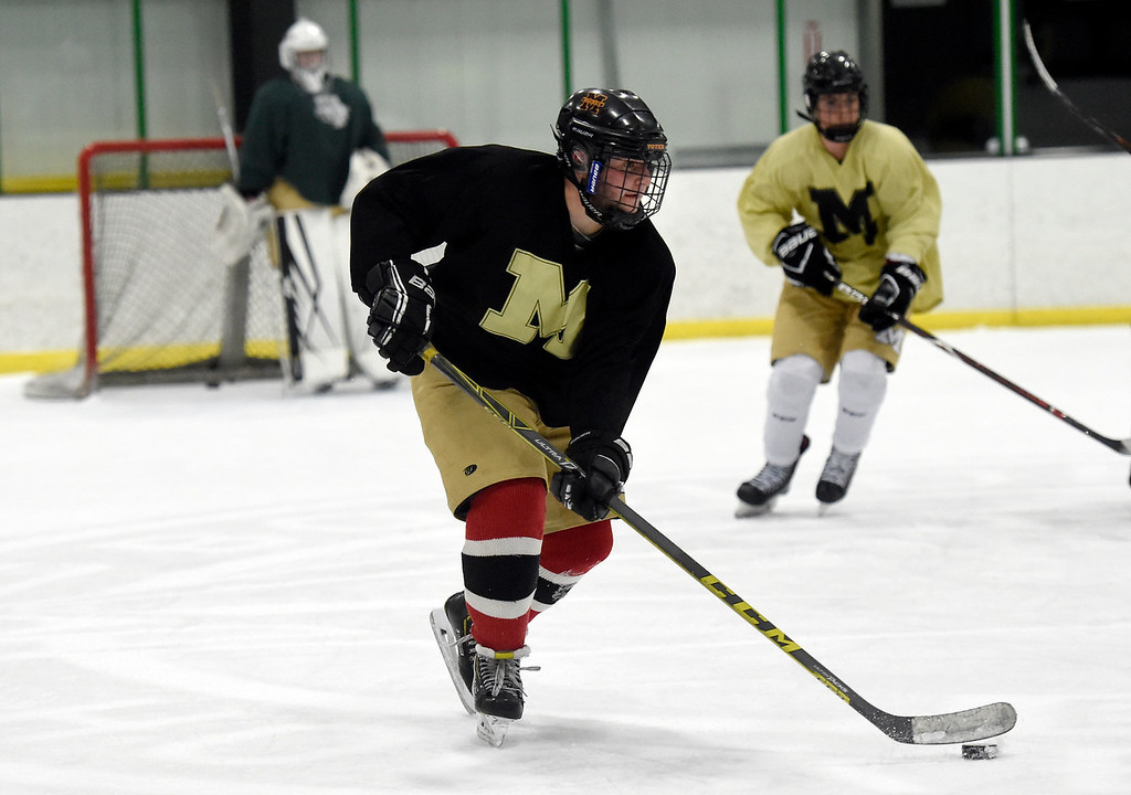 . SUPERIOR, CO - NOVEMBER 28, 2018: Monarch High School hockey player Jordan Finney moves the puck towards the goal during practice on Wednesday at the Sports Stable in Superior. More photos: BoCoPreps.com Jeremy Papasso/ Staff Photographer