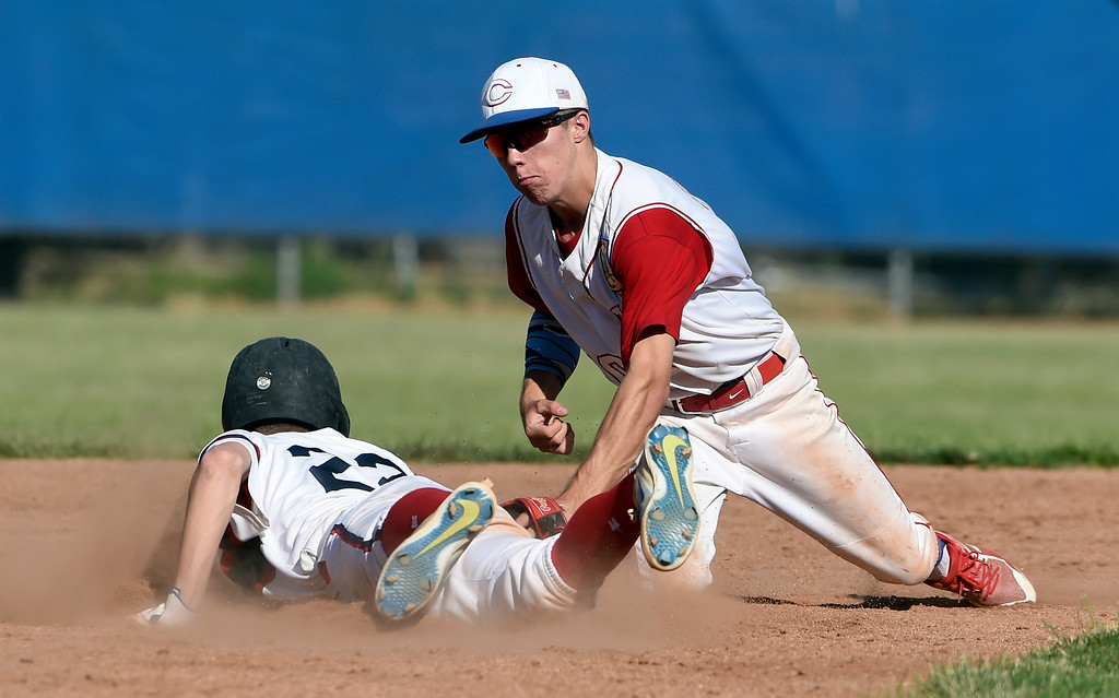 . Centaurus High School\'s Nick VanTassel misses the tag on a runner at second base during a NIT tournament game against the Impact on Wednesday at Centaurus High School in Lafayette. More photos: BoCoPreps.com Jeremy Papasso/ Staff Photographer 07/11/2018