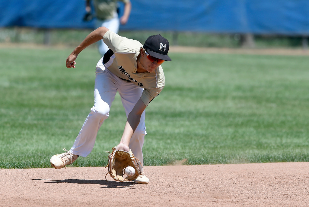 . Monarch\'s Andrew Morris makes a stop at short-stop for an out at first base during a NIT tournament game against the Impact on Wednesday at Centaurus High School in Lafayette. More photos: BoCoPreps.com Jeremy Papasso/ Staff Photographer 07/11/2018