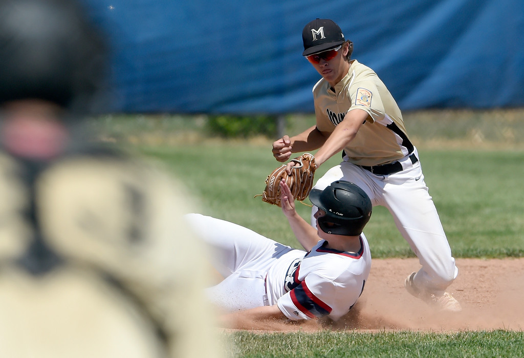 . Monarch\'s Andrew Morris misses the tag on Alex McDoughall at second base during a NIT tournament game against the Impact on Wednesday at Centaurus High School in Lafayette. More photos: BoCoPreps.com Jeremy Papasso/ Staff Photographer 07/11/2018