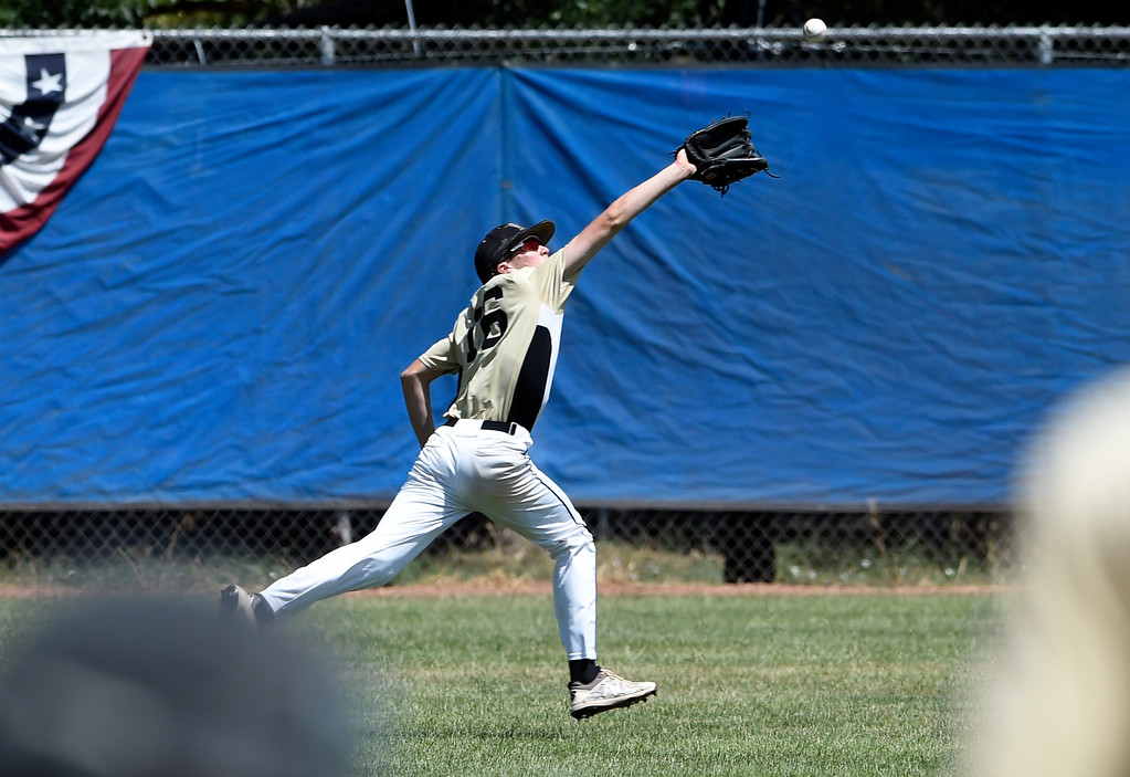 . Monarch\'s Corbin Cowan stretches to make a catch in the outfield during a NIT tournament game against the Impact on Wednesday at Centaurus High School in Lafayette. More photos: BoCoPreps.com Jeremy Papasso/ Staff Photographer 07/11/2018