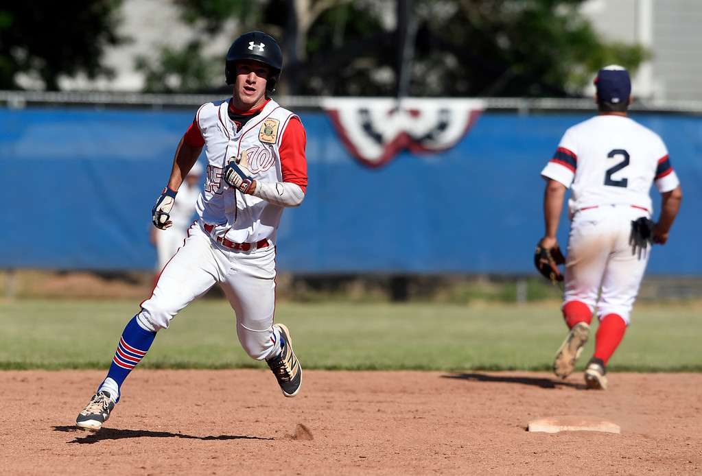 . Centaurus High School\'s Tucker Heroux rounds second base after hitting a triple during a NIT tournament game against the Impact on Wednesday at Centaurus High School in Lafayette. More photos: BoCoPreps.com Jeremy Papasso/ Staff Photographer 07/11/2018
