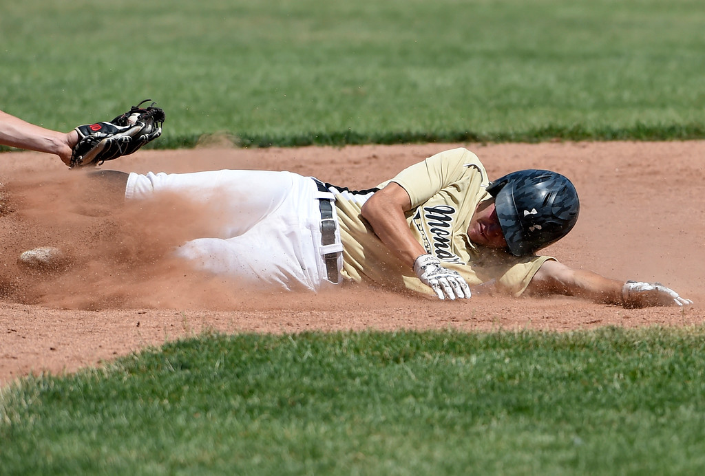 . Monarch\'s Nick Santman gets tagged out at second base during a NIT tournament game against the Impact on Wednesday at Centaurus High School in Lafayette. More photos: BoCoPreps.com Jeremy Papasso/ Staff Photographer 07/11/2018