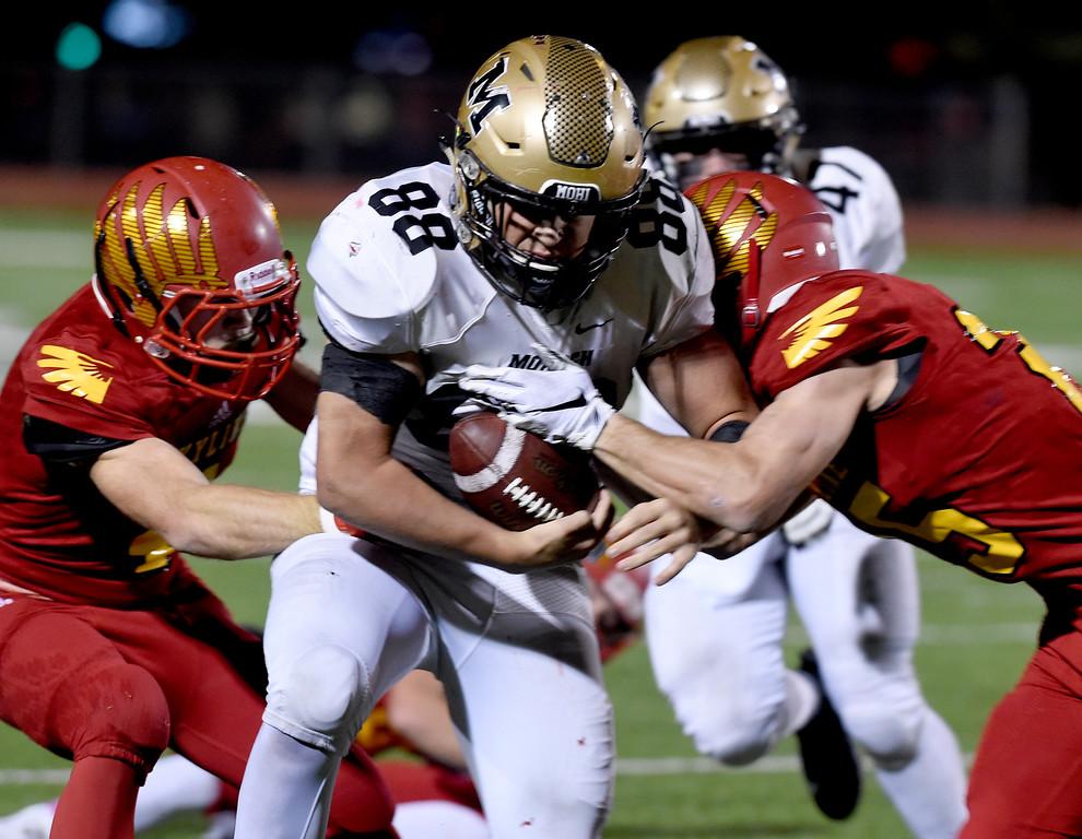 . LONGMONT, CO: October 12, 2018: Austin Fiala, of Monarch, gets past Kyle West, left, and Jack Wathen, of Skyline, during the  Monarch at Skyline game on October 12, 2018. (Photo by Cliff Grassmick/Staff Photographer)