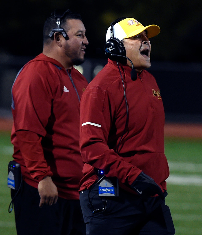 . LONGMONT, CO: October 12, 2018: Skyline head coach, Michael Silva, right, during the  Monarch at Skyline game on October 12, 2018. (Photo by Cliff Grassmick/Staff Photographer)