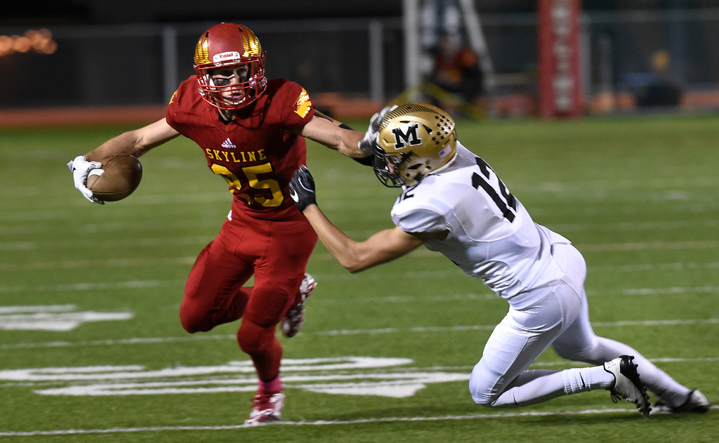 . LONGMONT, CO: October 12, 2018: Jack Wathen, of Skyline, escapes Sam Blanke, of Monarch, during the  Monarch at Skyline game on October 12, 2018. (Photo by Cliff Grassmick/Staff Photographer)