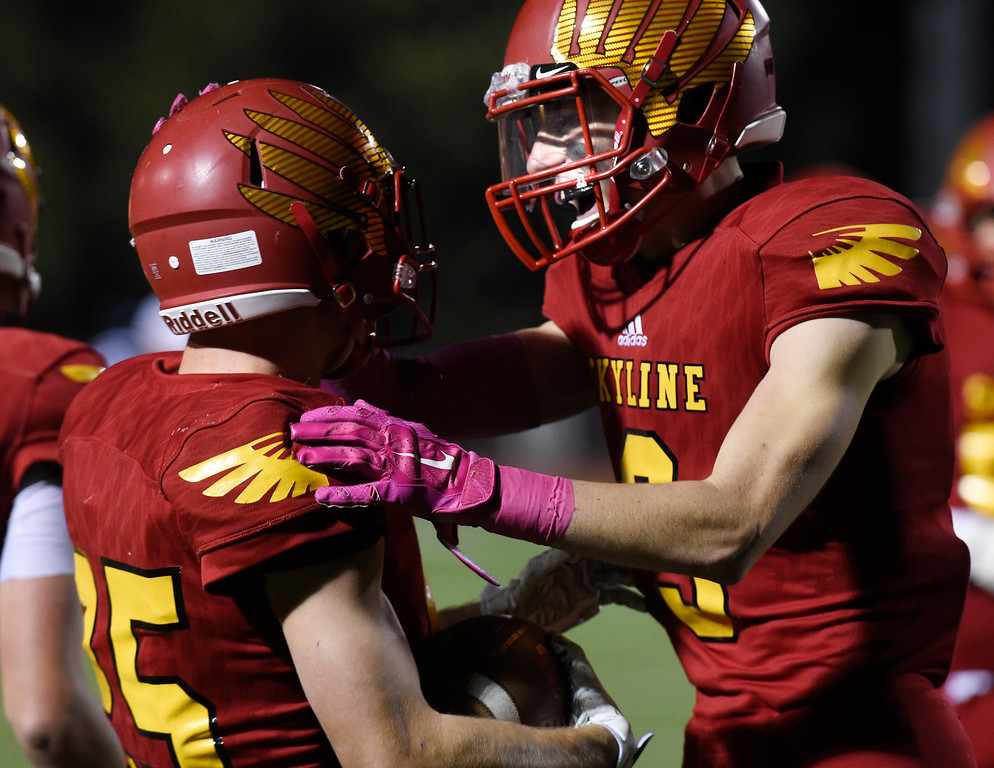 . LONGMONT, CO: October 12, 2018: Jack Wathen,  left,of Skyline,  gets congratulated by Andrew Dietz after scoring a TD during the  Monarch at Skyline game on October 12, 2018. (Photo by Cliff Grassmick/Staff Photographer)