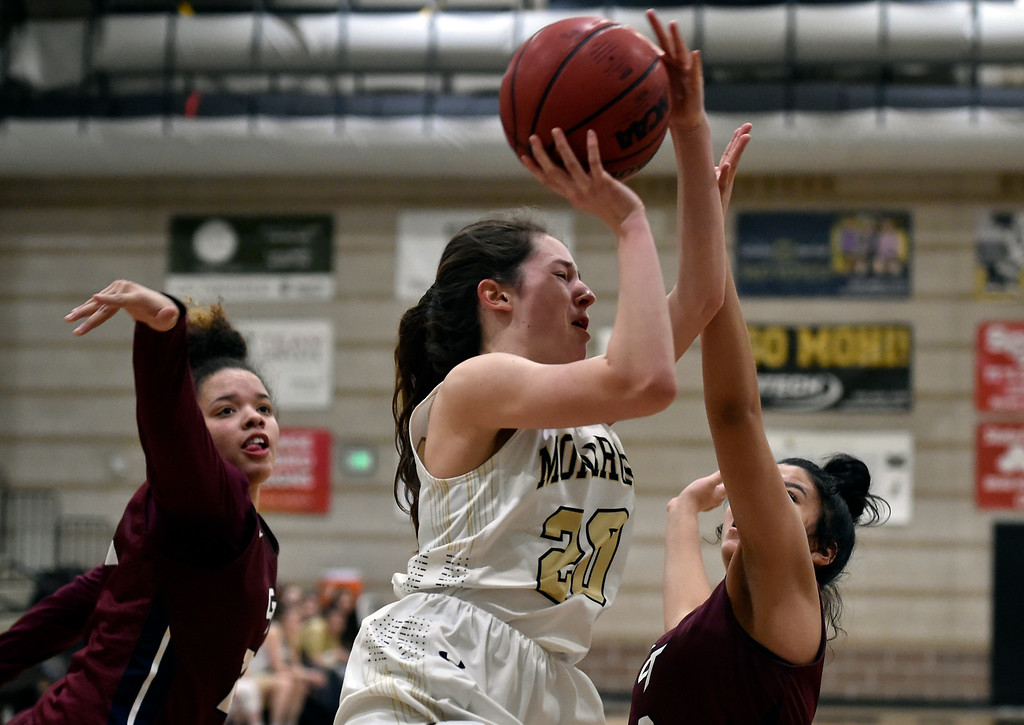 . LOUISVILLE, CO - FEBRUARY 19, 2019: Monarch High School\'s Anna Trujillo goes for a layup during a playoff game against Cherokee Trail on Tuesday in Louisville. More photos: BoCoPreps.com (Photo by Jeremy Papasso/Staff Photographer)