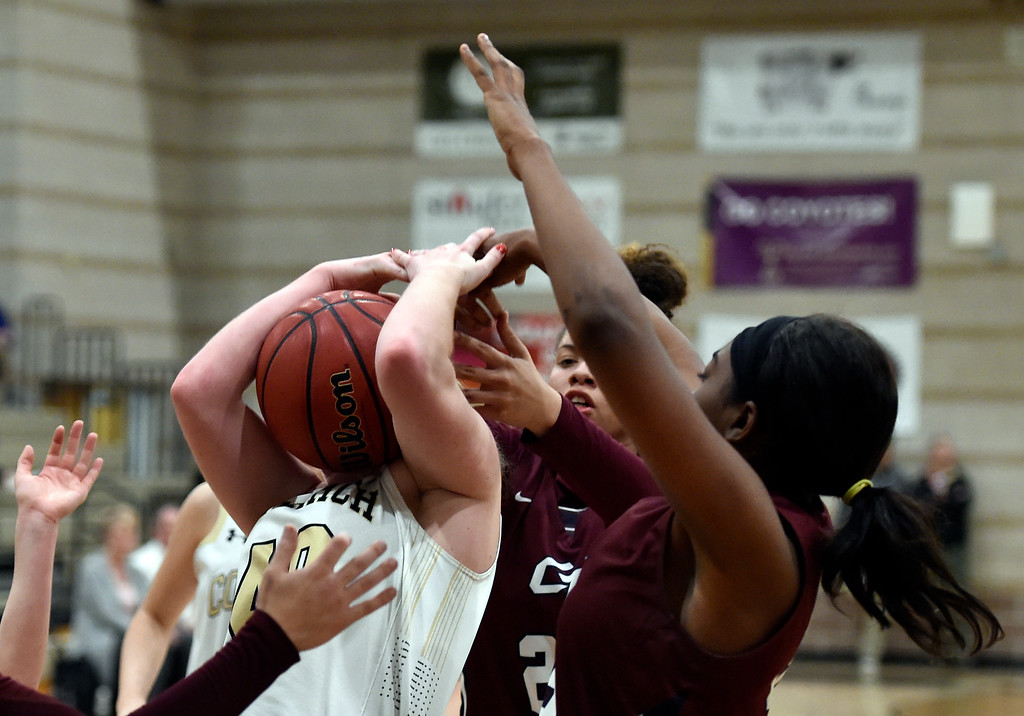 . LOUISVILLE, CO - FEBRUARY 19, 2019: Monarch High School\'s Emerson Herrmann grabs a rebound during a playoff game against Cherokee Trail on Tuesday in Louisville. More photos: BoCoPreps.com (Photo by Jeremy Papasso/Staff Photographer)