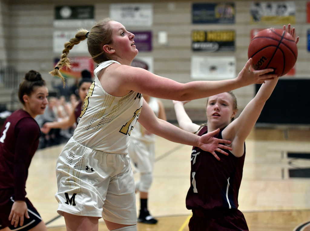 . LOUISVILLE, CO - FEBRUARY 19, 2019: Monarch High School\'s Nicole Reading goes for a layup during a playoff game against Cherokee Trail on Tuesday in Louisville. More photos: BoCoPreps.com (Photo by Jeremy Papasso/Staff Photographer)