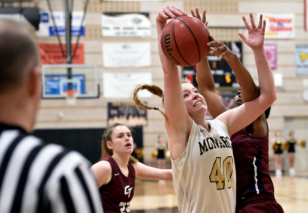 . LOUISVILLE, CO - FEBRUARY 19, 2019: Monarch High School\'s Emerson Herrmann gets her shot blocked by Yolanda Fason during a playoff game against Cherokee Trail on Tuesday in Louisville. More photos: BoCoPreps.com (Photo by Jeremy Papasso/Staff Photographer)