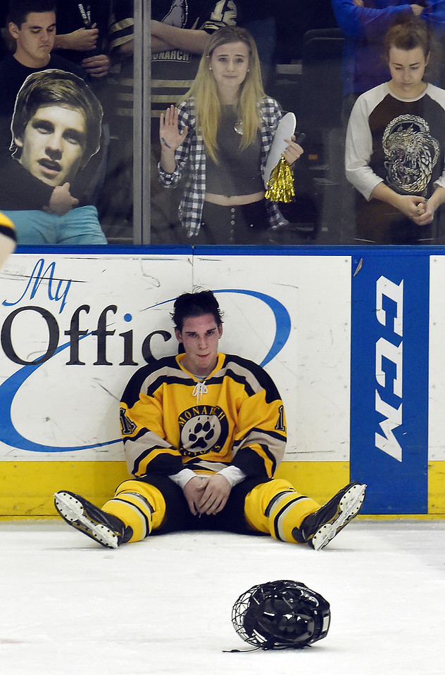 """Monarch's Adam Tybor sits at the edge of the ice next to fans after the Coyote's were defeated by Regis Jesuit in the state hockey championship game at the Budweiser Events Center in Loveland on Saturday.<br /> More photos:  <a href=""""http://www.BoCoPreps.com"""">http://www.BoCoPreps.com</a><br /> David R. Jennings/Staff Photographer<br /> March 5, 2016"""