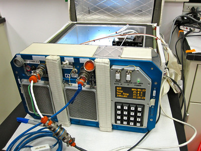 """BioServe Space Technologies' """"Commercial Generic Bioprocessing Apparatus"""" (CGBA) which will house the  monarch rearing chamber on the International Space Station. Photo by Jim Lovett"""