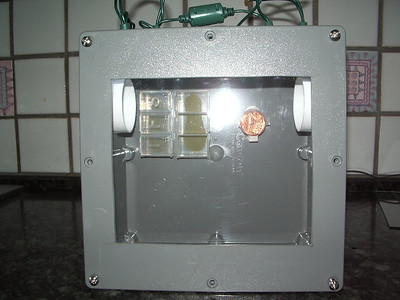 I got a 8x8x4 electric junction box at Home Depot. Cut out a window and covered with plexiglass. Put some roof vents in the side, pill box feeder inside along with cotton ball  holder. Put some LED Christmas lights in the top that are on a timer.  Also put a piece of balsa wood on the top. It wasn't cheap, but it's way cool! I will use it every year when we do our Monarch project! Photo 2 of 2, submitted by Scott D.