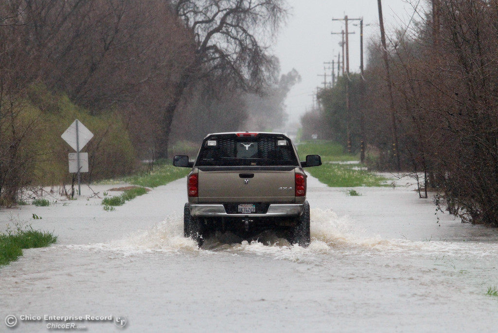 . Not recommended, yet this truck took it\'s chances driving through a flooded area of Center House Road February 20, 2017 in Oroville, California. (Emily Bertolino -- Mercury Register)