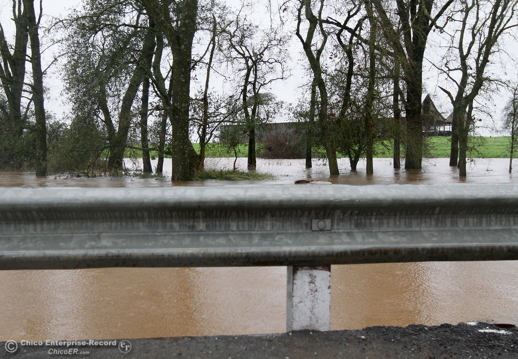 . The water flows swiftly under the bridge along Center House Road February 20, 2017 in Oroville, California. (Emily Bertolino -- Mercury Register)