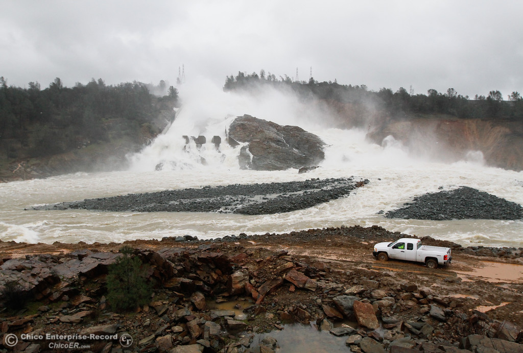 . Crews prepare to clear away the debris that\'s building up at the base of the spillway February 20, 2017 in Oroville, California. (Emily Bertolino -- Mercury Register)