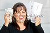 Middle Aged Woman Holding Bills Due and Currency