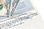 Stock Certificate Shares with US One Hundred Dollar Bills