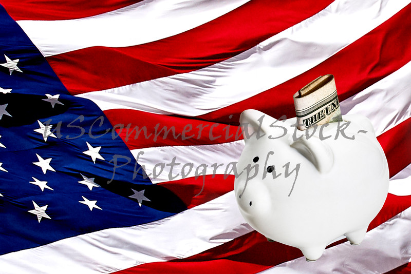 Piggy bank with Money on an American Flag