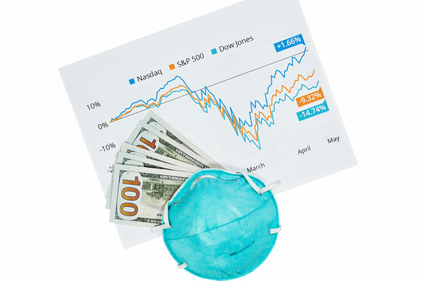 Stock Market Graph with Money and a Face Mask