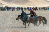 Fighting for the goat skin, Kukhbar competition, Eagle Festival, Olgii, Western Mongolia