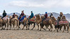 The camel racers proceeding to the start line at the Eagle Festival, Olgii, Western Mongolia