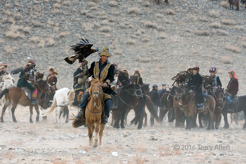 Competitor on a light brown horse Eagle Festival, Olgii, Western Mongolia