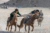 Kukhbar competitors fight for the goat skin, Eagle Festival, Olgii, Western Mongolia