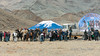 Arrival of the eagle hunters at the Olgii Eagle Festival, Western Mongolia (best larger)<br /> <br /> The arrival of the eagle hunters is eagerly awaited by the crowds of locals and tourist who surround them taking photos, films and doing interviews.  The blue tent is the VIP tent and the large banner is at the back of a stage where the welcome ceremonies take place.