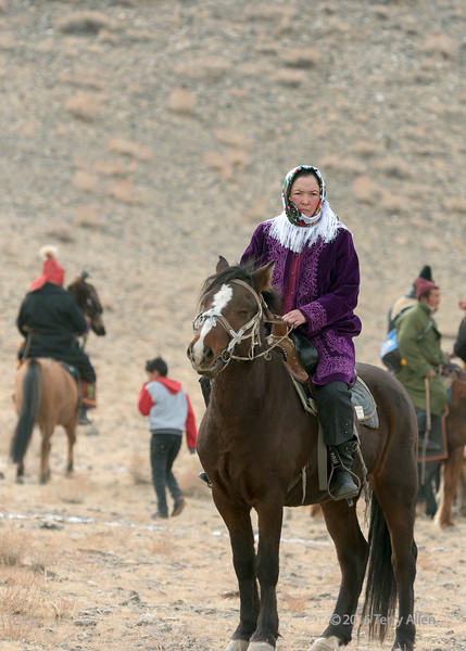 Mongolian woman rider, Eagle Festival, Olgii, Western Mongolia<br /> <br /> She was the wife of one of the dignitaries.  It was unusual to see a woman mounted on a horse during my time in Mongolia